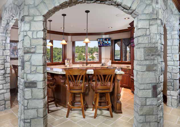 When the couple decided to build a home at the Lake of the Ozarks, they poured over designs for more than seven years before engaging the services of Thomas Construction and Chris Derrick of Warrenville, Illinois.